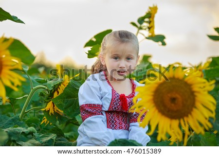 little girl on the field with sunflowers