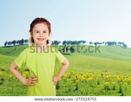 Little girl on the green meadow in sunny day - stock photo