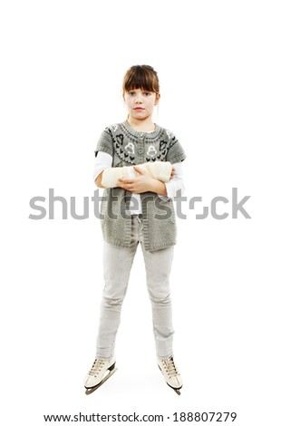 Little girl on the ice skates with broken arm. Isolated on white background  - stock photo