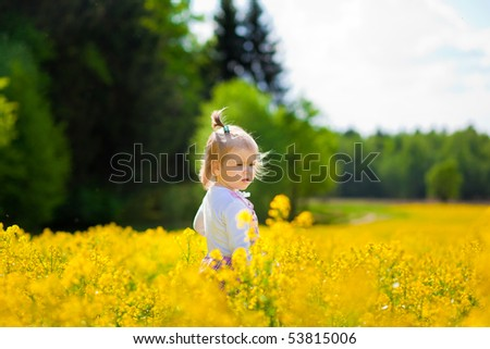 Little girl on the meadow - stock photo