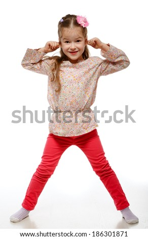 Little girl on the move. Cheerful, positive. Naughty child. Girl jumping. - stock photo