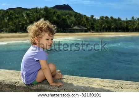 Little girl on the peer, having fun - stock photo
