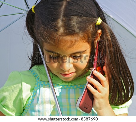 Little Girl on the Phone - stock photo