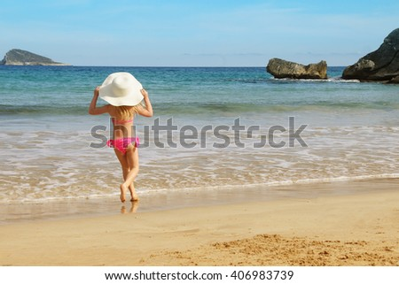 Little girl on the sand beach. Summer vacation