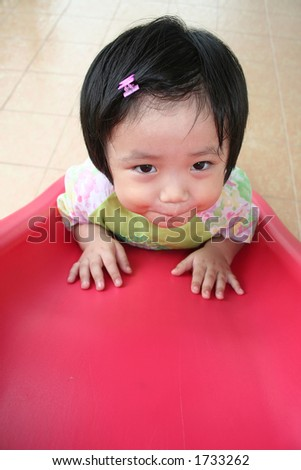Little girl on the slide - stock photo