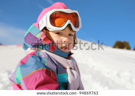 Little girl on the snow - stock photo