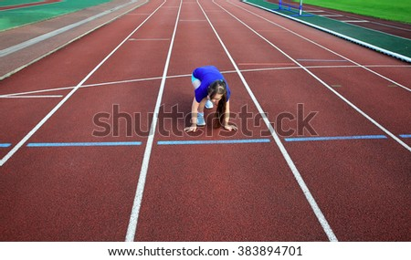 Little girl on the start on the stadium