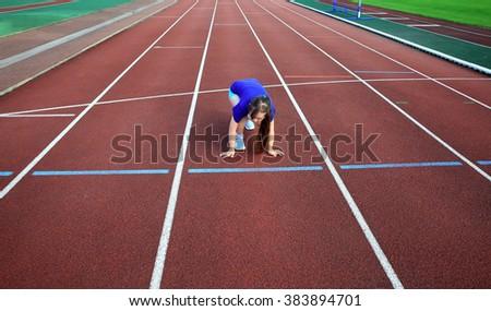 Little girl on the start on the stadium - stock photo