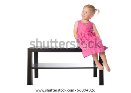 little girl on the table isolated - stock photo