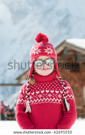 Little girl on winter vacation - stock photo