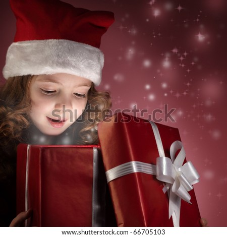 little girl open red gift box - stock photo
