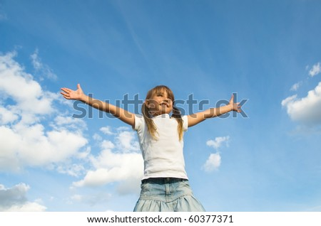 Little girl outdoor standing high with her hand outstretched - stock photo