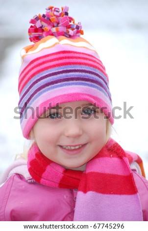 little girl outside in snow - stock photo