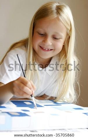 Little girl painting - stock photo