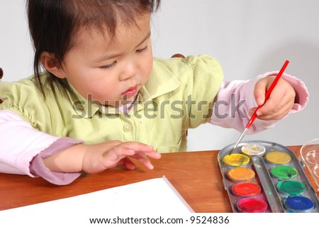 little girl painting - stock photo