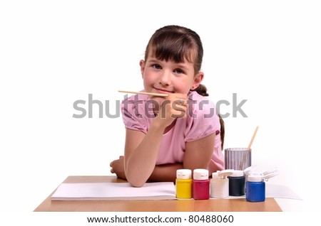 Little girl painting a picture with colorful paints isolated on white background - stock photo