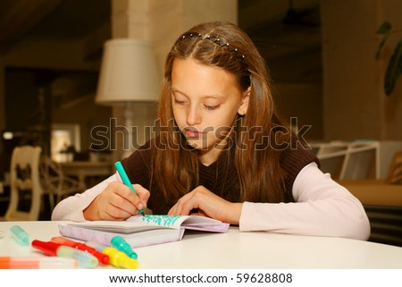 little girl painting at home - stock photo