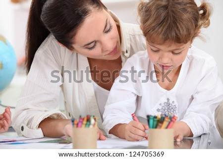 little girl painting at school - stock photo