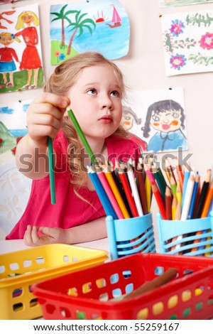 Little girl  painting by pencil in art class. - stock photo