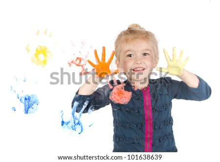 Little girl painting hand prints on window, isolated on white background - stock photo