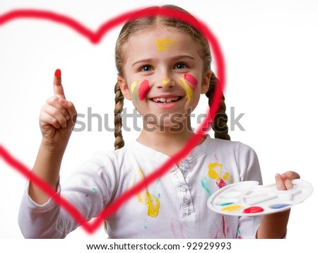 Little girl painting heart - stock photo