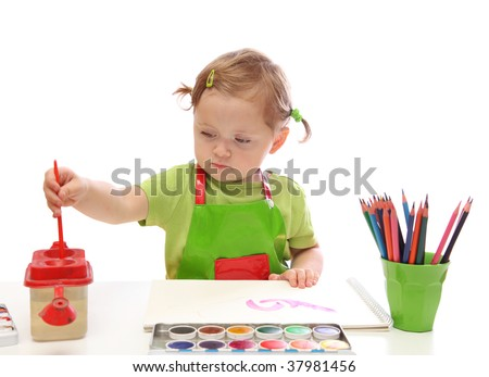 Little girl painting isolated on white background - stock photo