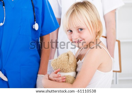 little girl patient in doctor's office - stock photo