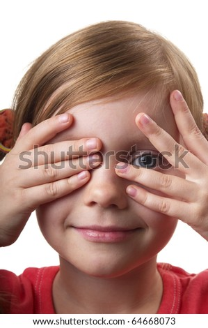 Little girl peep thru hand with one eye isolated over white background - stock photo
