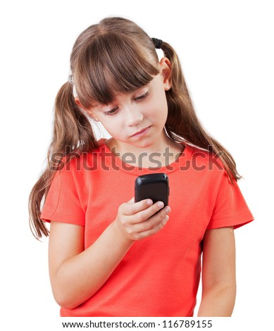 Little girl picking up a mobile phone number - stock photo