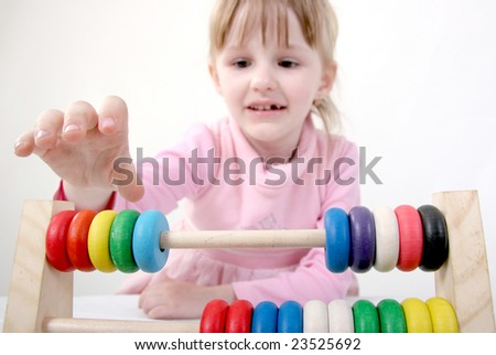 little girl play with abacus - stock photo