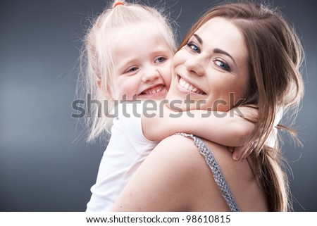 little girl play with mother - stock photo