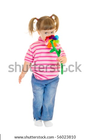 Little girl play with toy flower isolated - stock photo