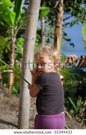 Little girl played with leaf in jungle - stock photo