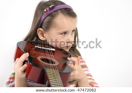 little girl playing acoustic guitar - stock photo