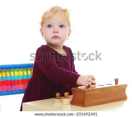 little girl playing an exciting game. Isolated on white background . - stock photo