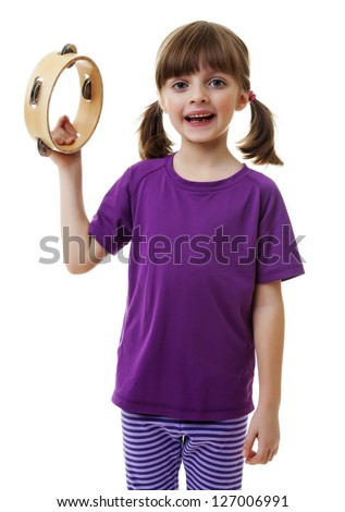 little girl playing and singing - tambourine - stock photo