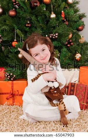 Little girl playing at Christmas - stock photo
