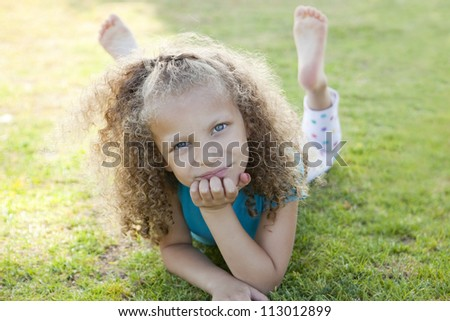 Little girl playing at the park - stock photo