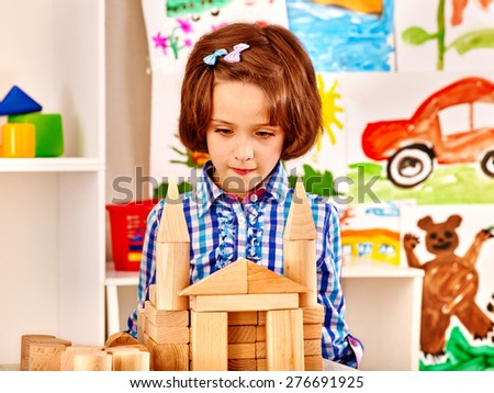 Little girl playing bricks. Child picture. - stock photo