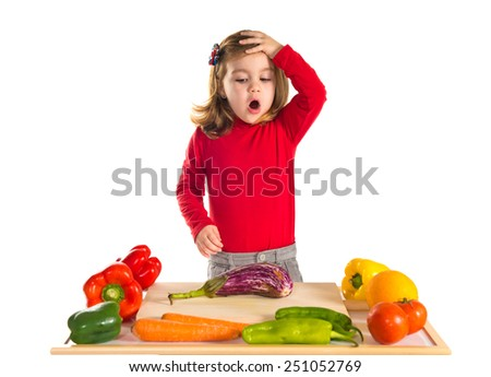 Little girl playing cooking - stock photo