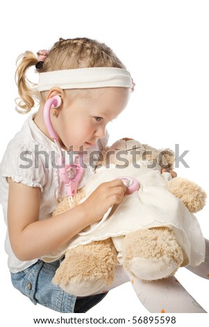 little girl playing doctor - stock photo