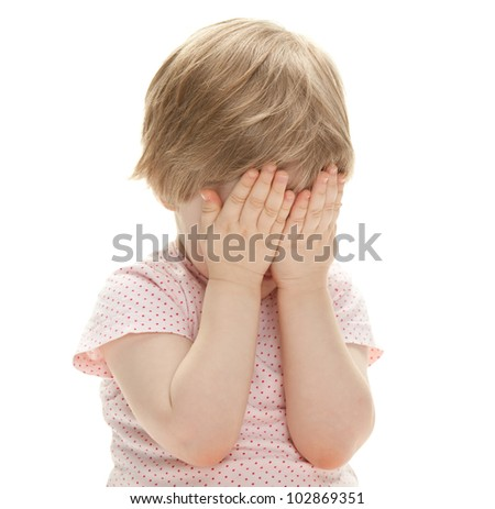 Little girl playing hide-and-seek isolated on white - stock photo