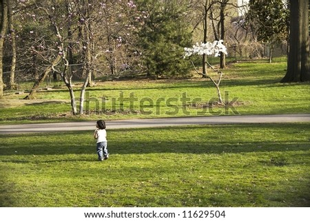 Little girl playing in Central Park in New York City.