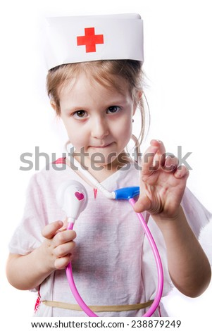 little girl playing in doctor - stock photo