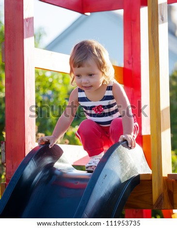 Little girl playing in park - stock photo