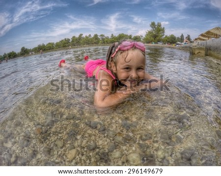 little girl  playing in sea