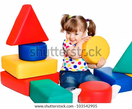 little girl playing in the constructor - stock photo