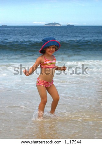 Little Girl Playing in the Ocean. - stock photo