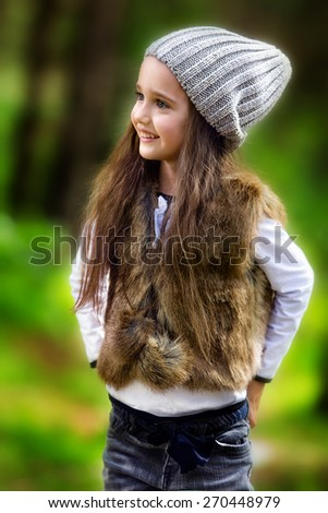 Little girl playing in the park - stock photo