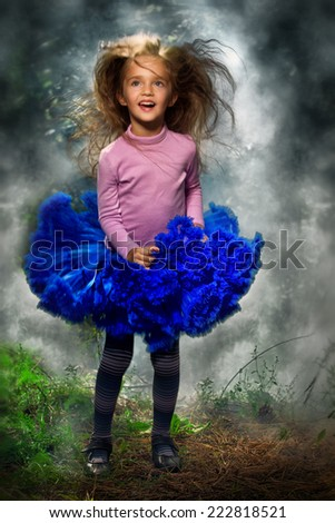 Little girl playing in the smoking forest - stock photo